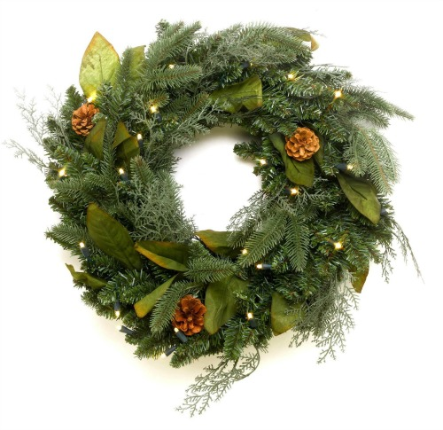 green spruce Christmas wreath with pine cones