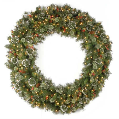 large christmas wreath with lights and pine cones