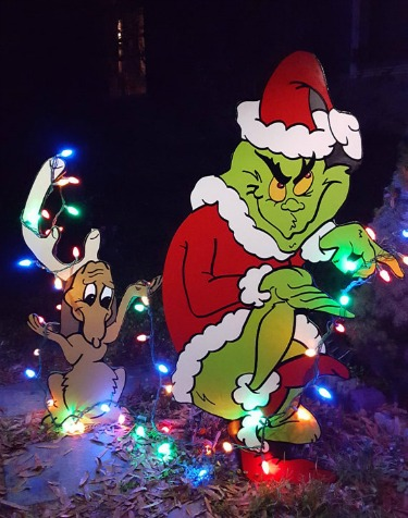The grinch and max stealing christmas lights decoration